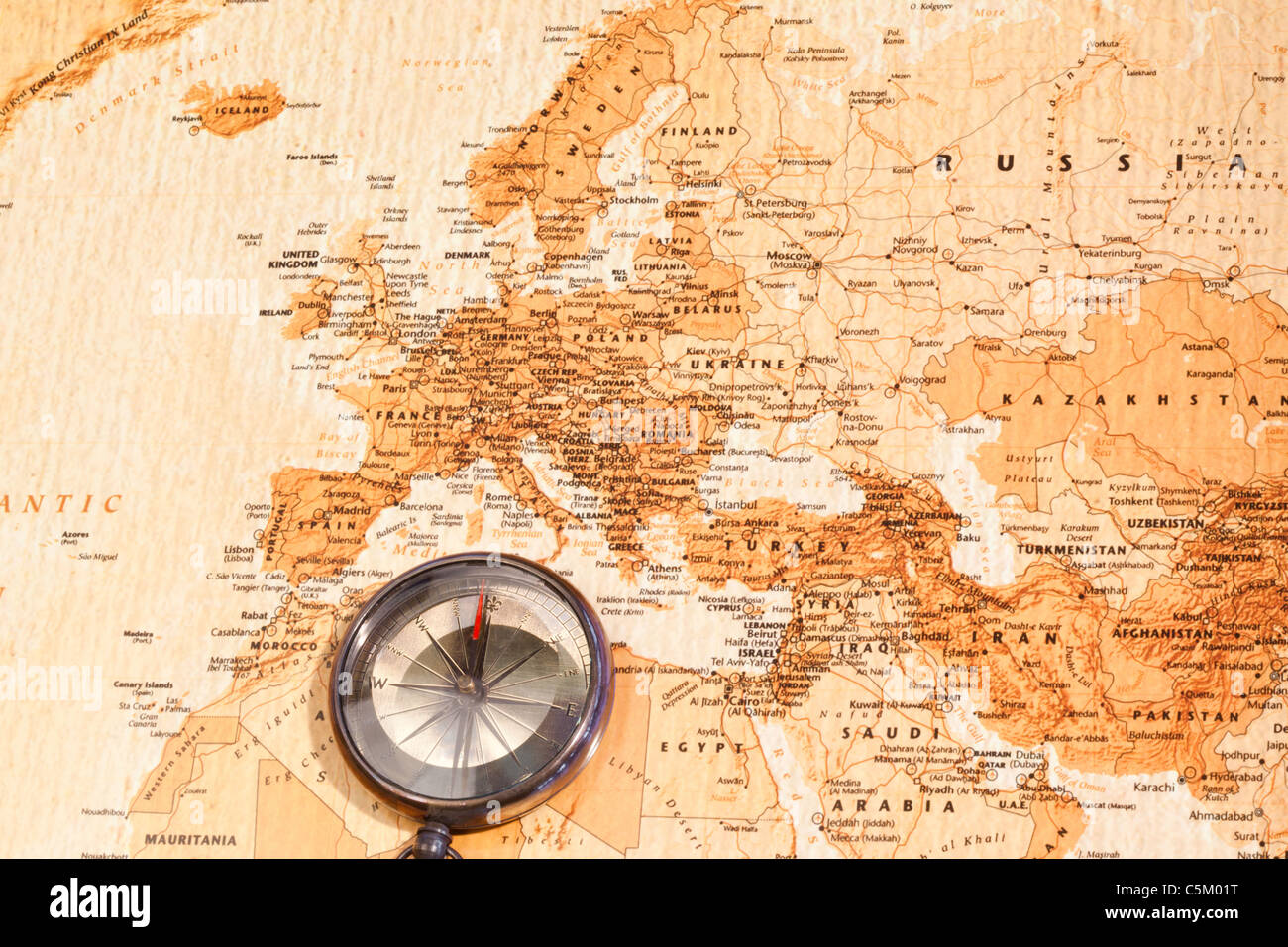 World map with compass showing Europe and the Middle East - Stock Image
