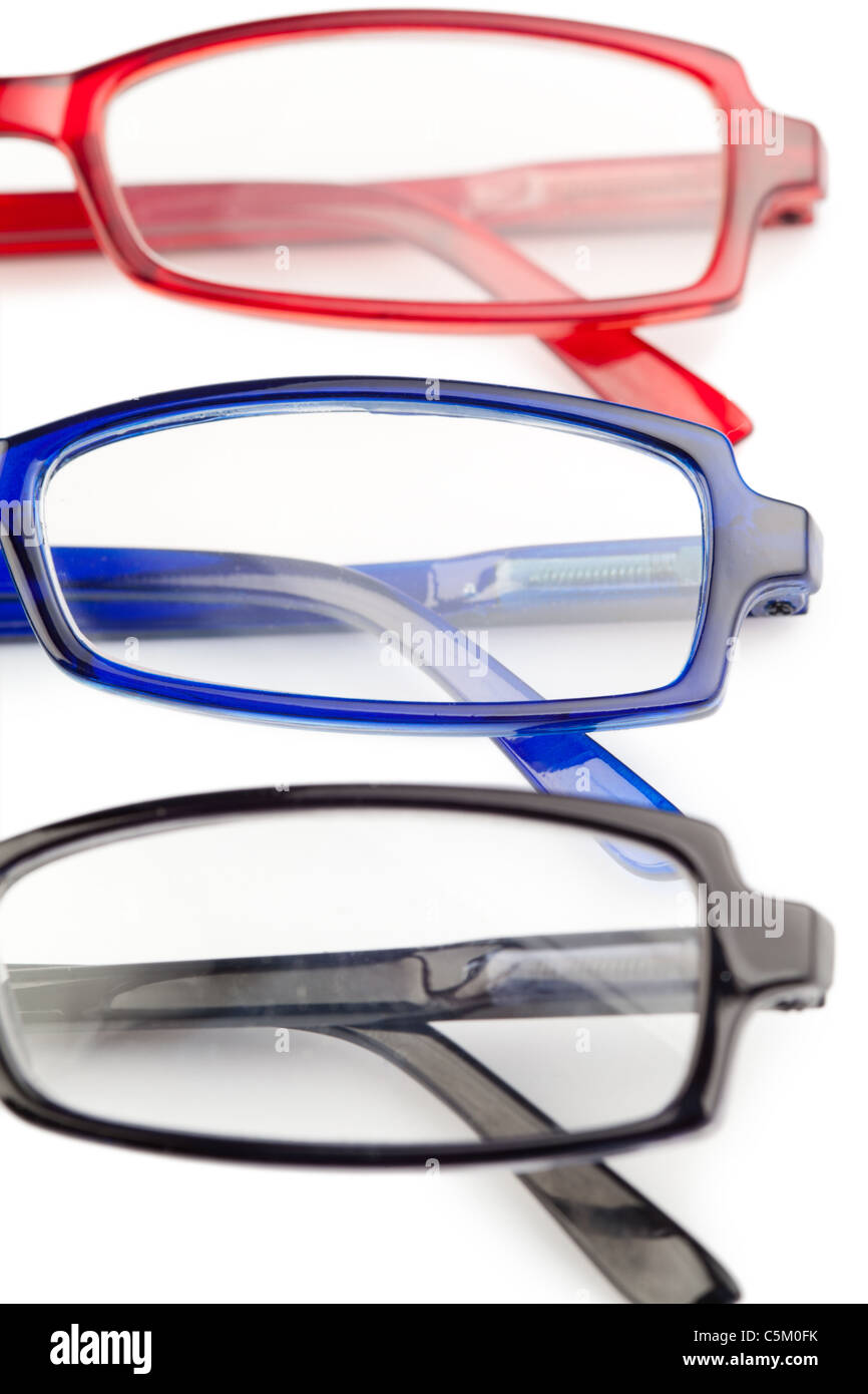Spectacles with blue frames black frames and red frames - Stock Image