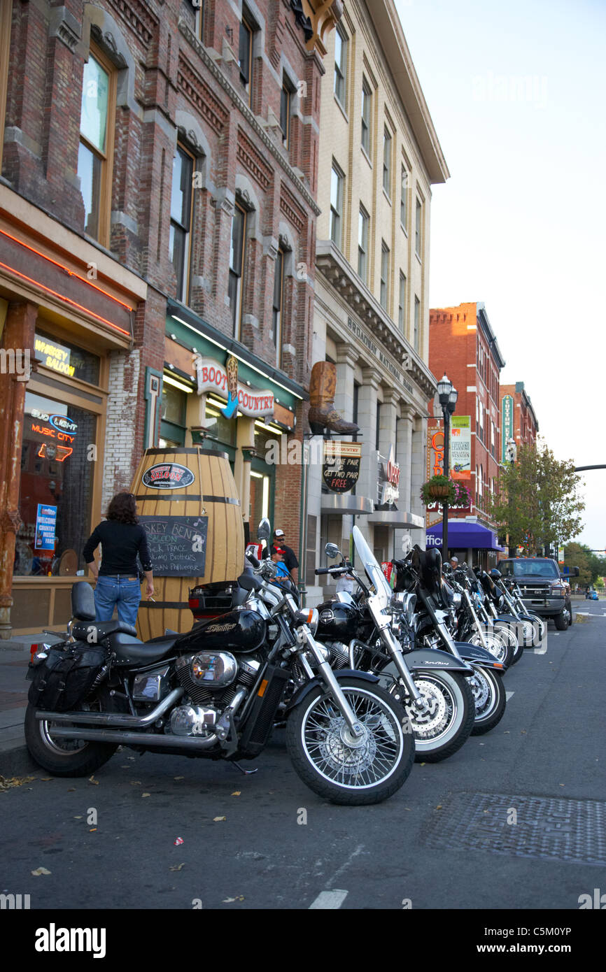 row of motorcycles including harley davidson on broadway downtown Nashville Tennessee USA - Stock Image