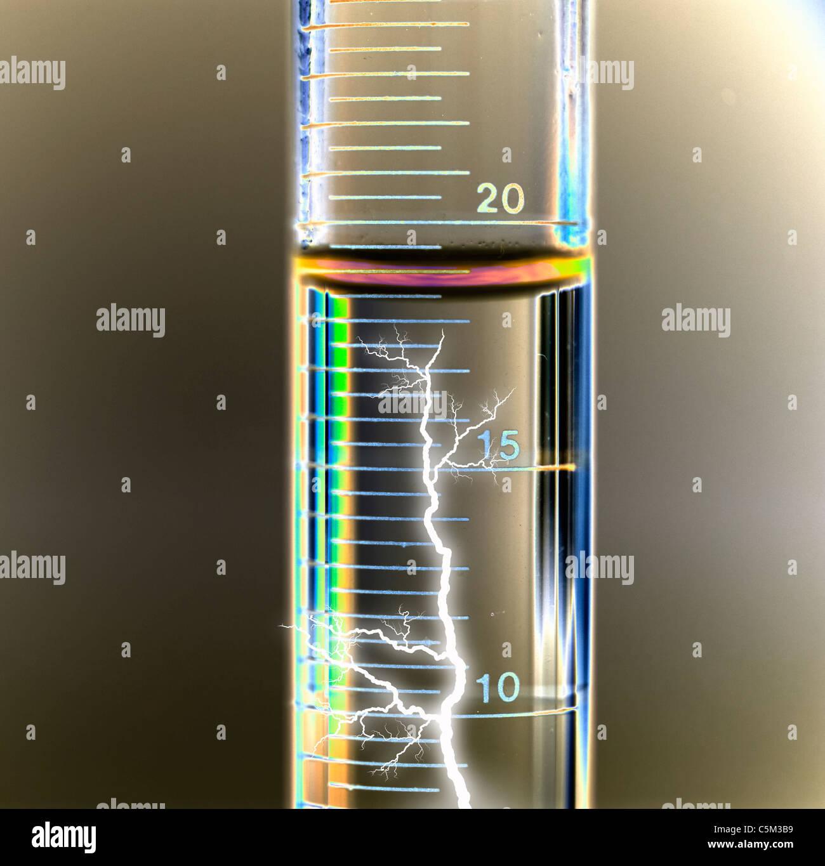 lightning  bolt inside calibrated test tube - Stock Image