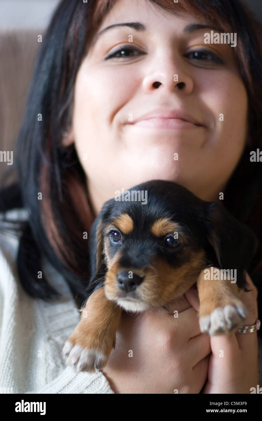 A Woman Holding A Newborn Puppy Mixed Breed Of A Yorkshire Terrier Stock Photo Alamy
