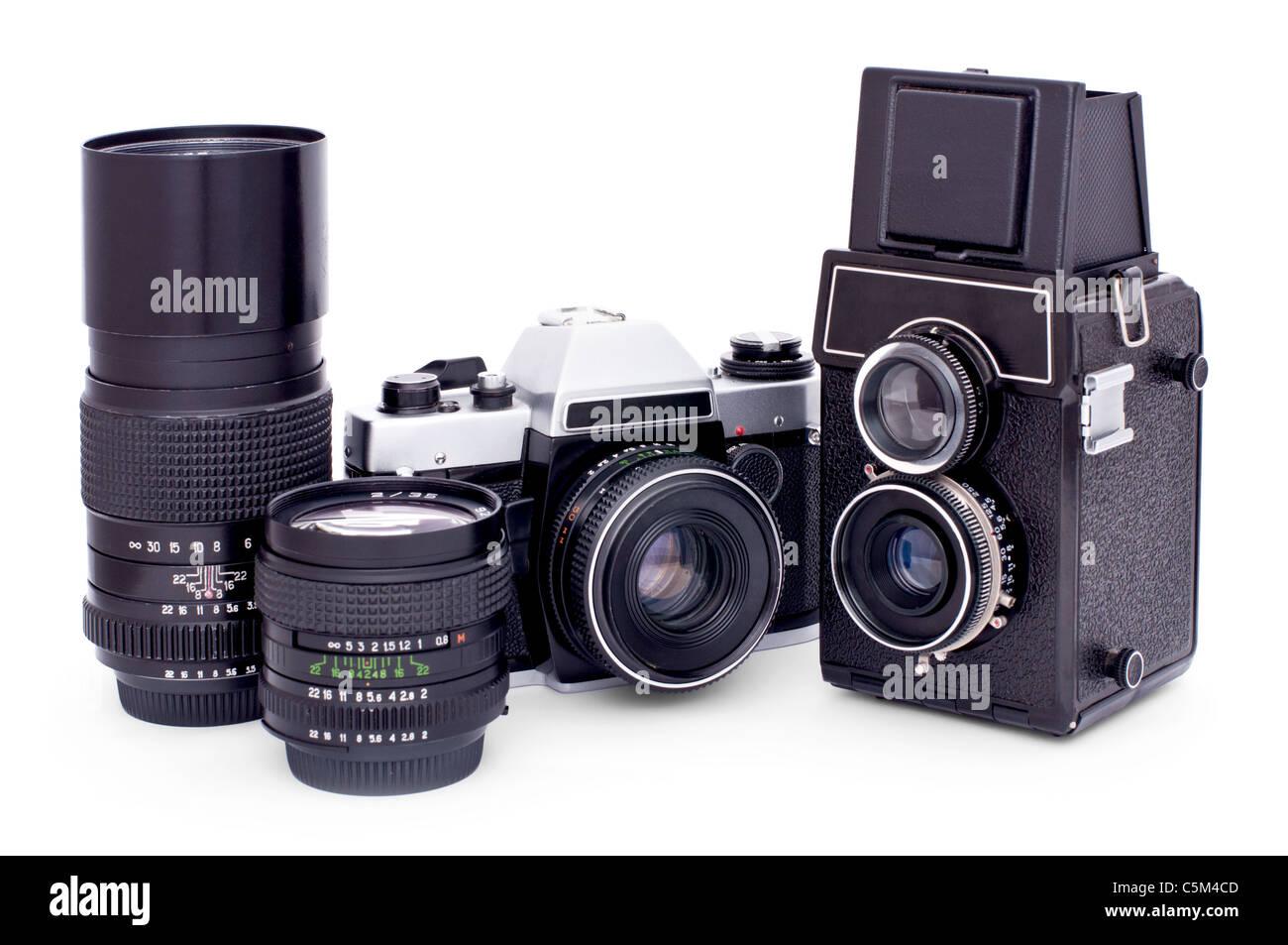 Soviet retro photo cameras and lenses isolated on white background - Stock Image