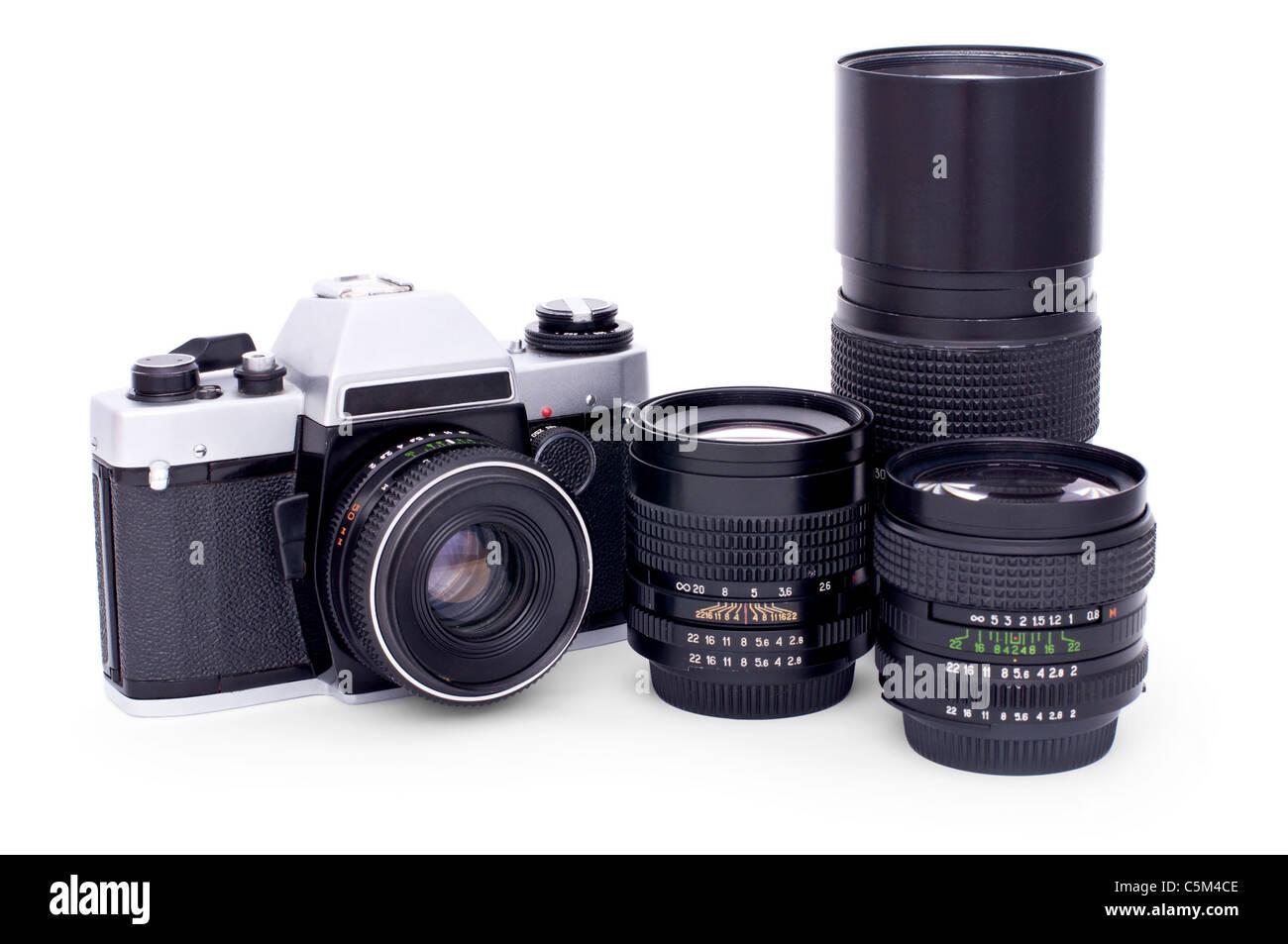 Soviet retro photo camera and lenses isolated on white background - Stock Image