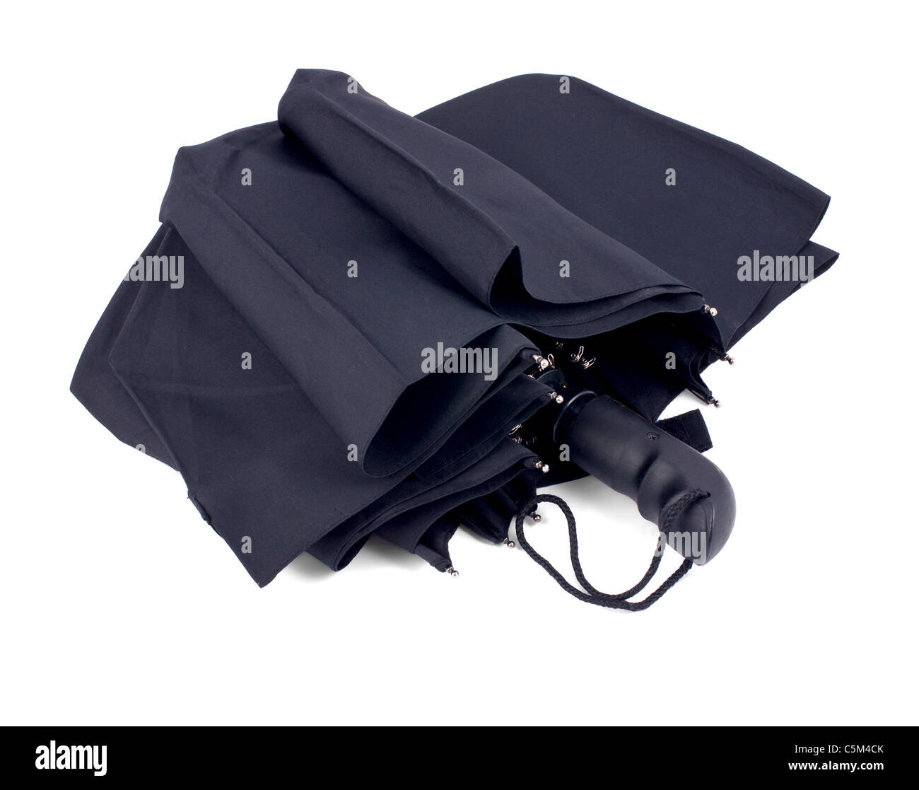 Closed black umbrella isolated on white background - Stock Image