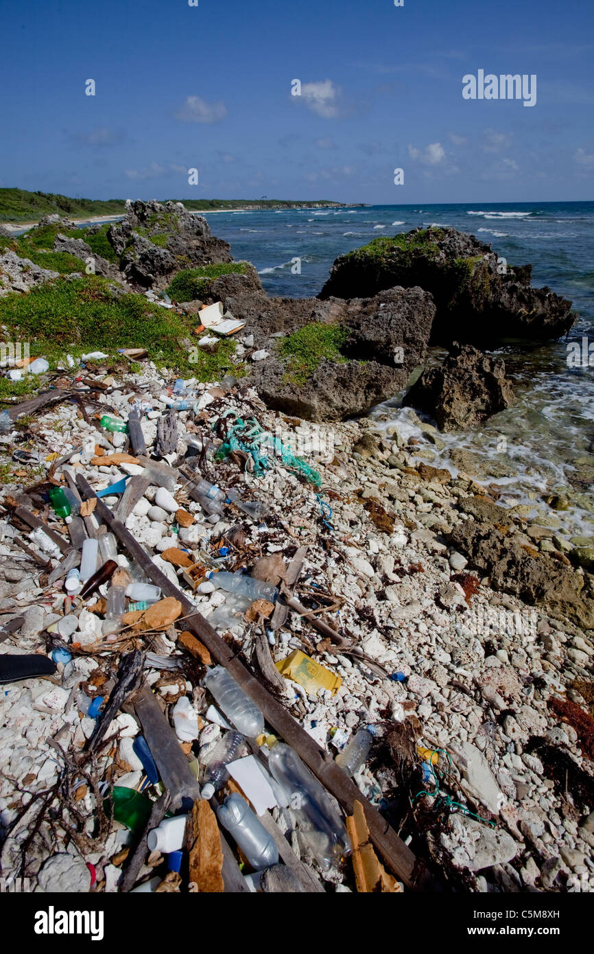 Marine debris including trash and plastics washed up along the shore of Swan Island, located 90 miles off the coast - Stock Image