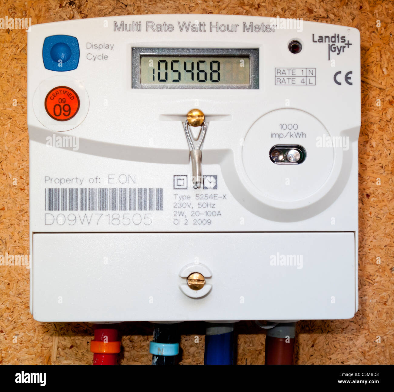 Multi Rate Watt Hour Electricity meter installed in a domestic house in the UK used to provide energy consumption Stock Photo