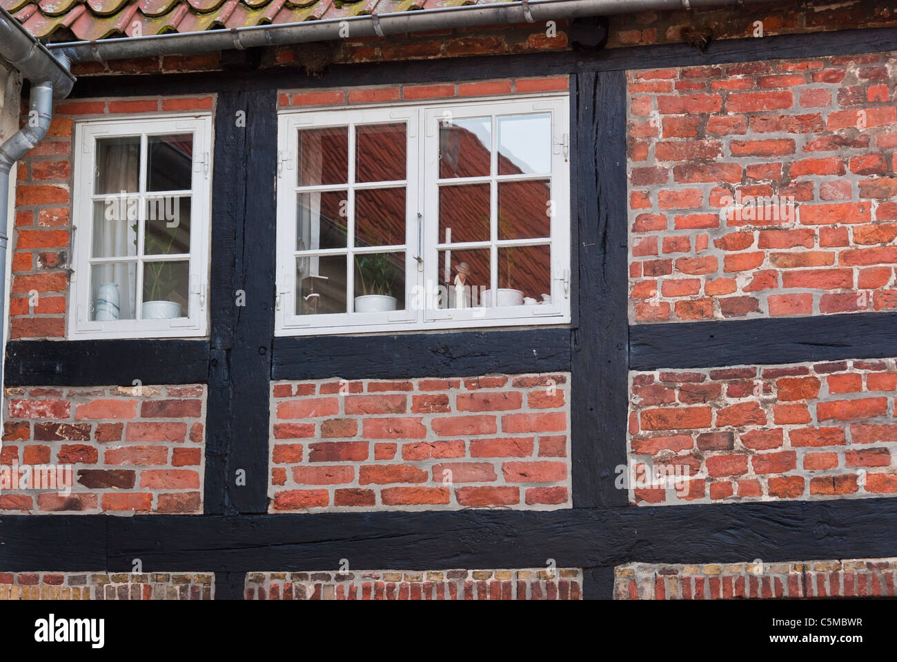 Detail of the facade of a timber-framed house with window - Stock Image