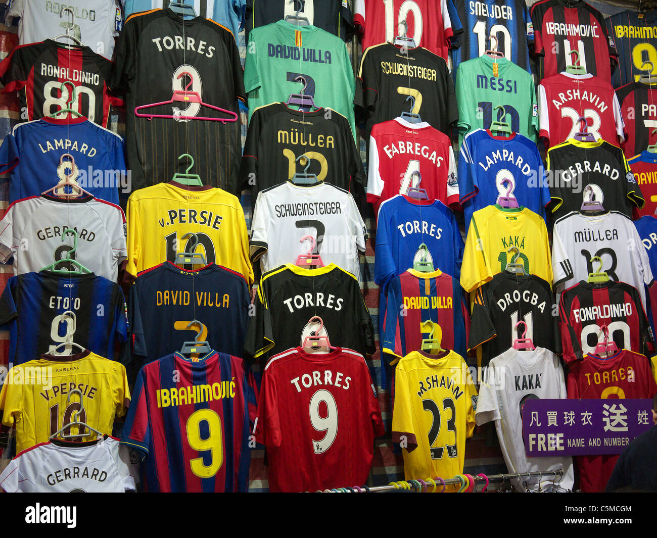 the latest 3354d 73a0d Premiership soccer shirts on display for sale at a night ...