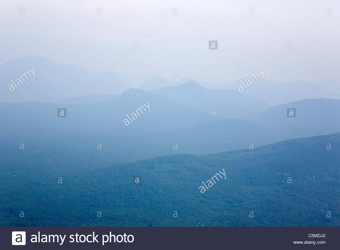 Hazey mountain scene on a hot and humid day from Middle Sister Trail in the White Mountains, New Hampshire USA. - Stock Image