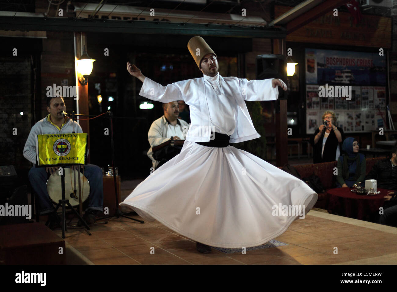 Whirling Dervish dancing  in Istanbul, Turkey - Stock Image