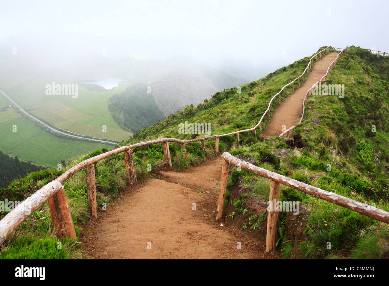 Empty walking trail in foggy weather nearby Sete Cidades crater. Sao Miguel island, Azores, Portugal. - Stock Image