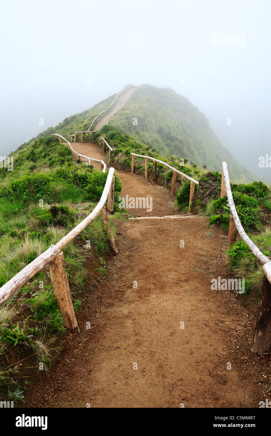 Empty walking trail in foggy weather. Nearby Sete Cidades crater. Sao Miguel island, Azores, Portugal. - Stock Image