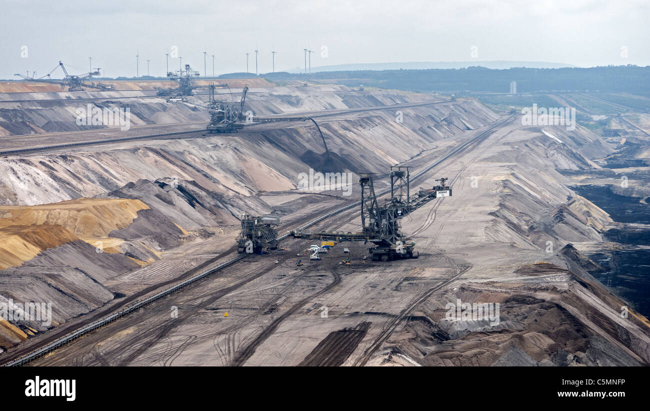 Large excavation machines working in RWE open-cast brown or lignite coal mine at Garzweiler in Northrhine Westfallia Stock Photo