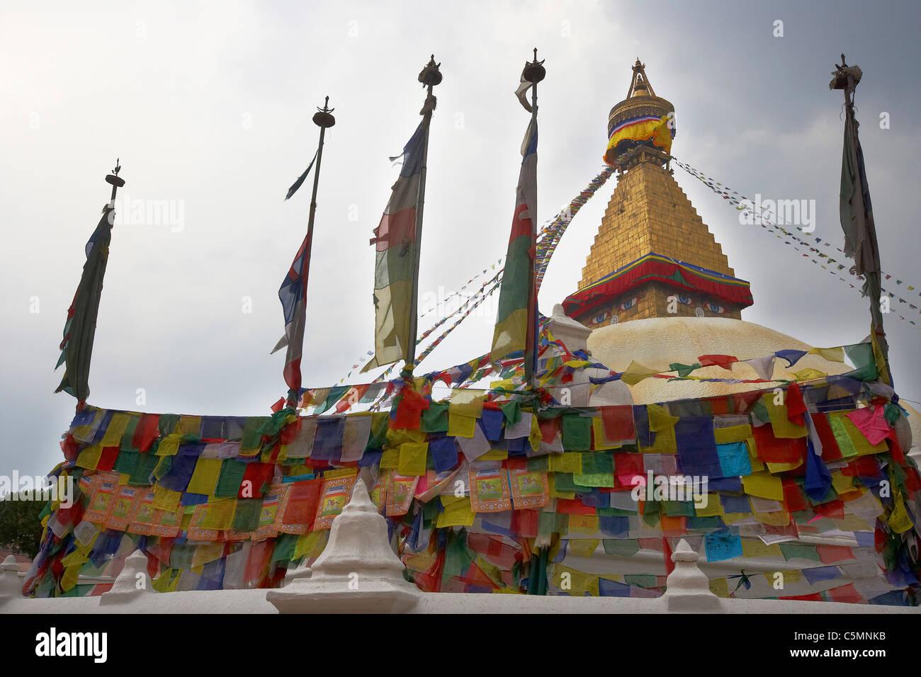The eyes of the Buddha gaze out from the Boudhanath stupa, Bodhnath (Boudha), Kathmandu Valley, Nepal, Asia. - Stock Image