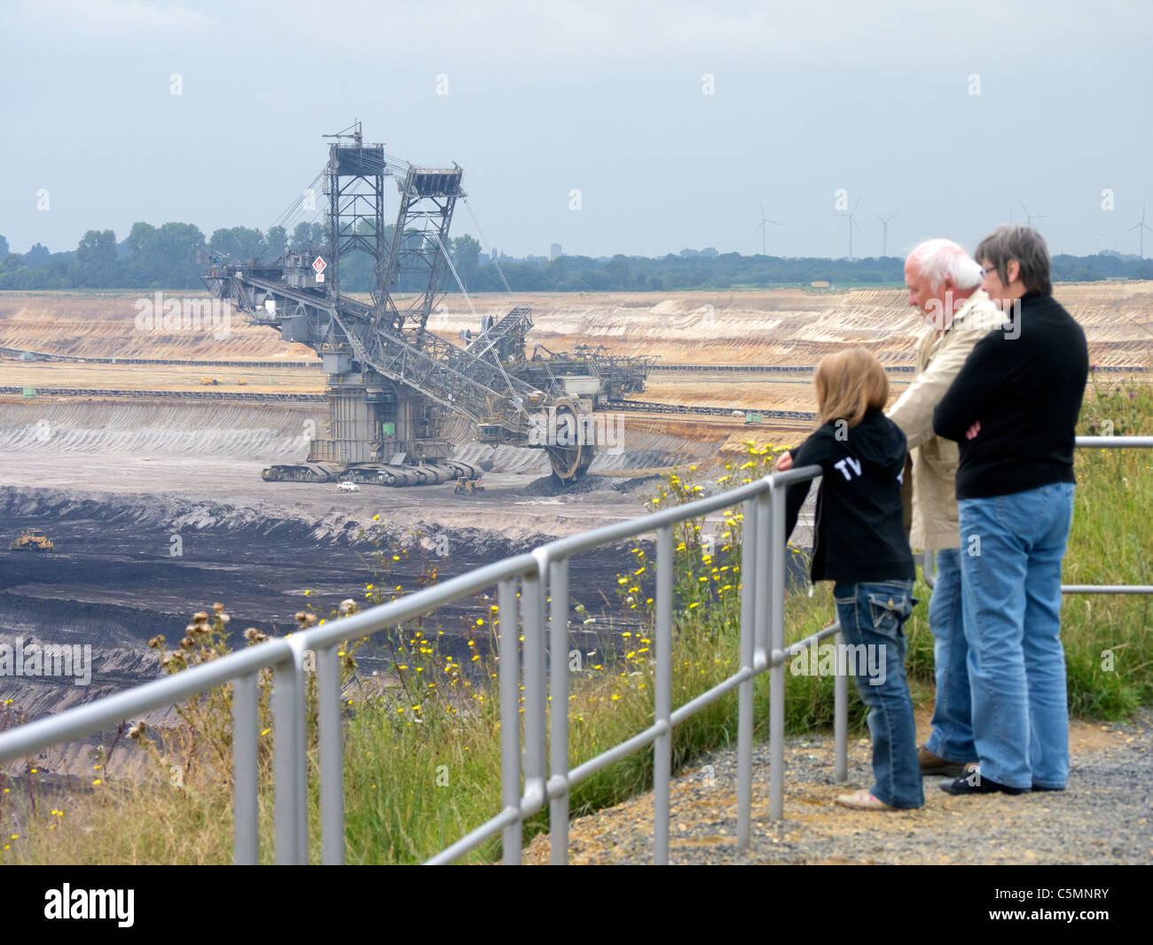Visitors looking at RWE open-cast brown or lignite coal mine at Garzweiler in Northrhine Westfallia in Germany Stock Photo