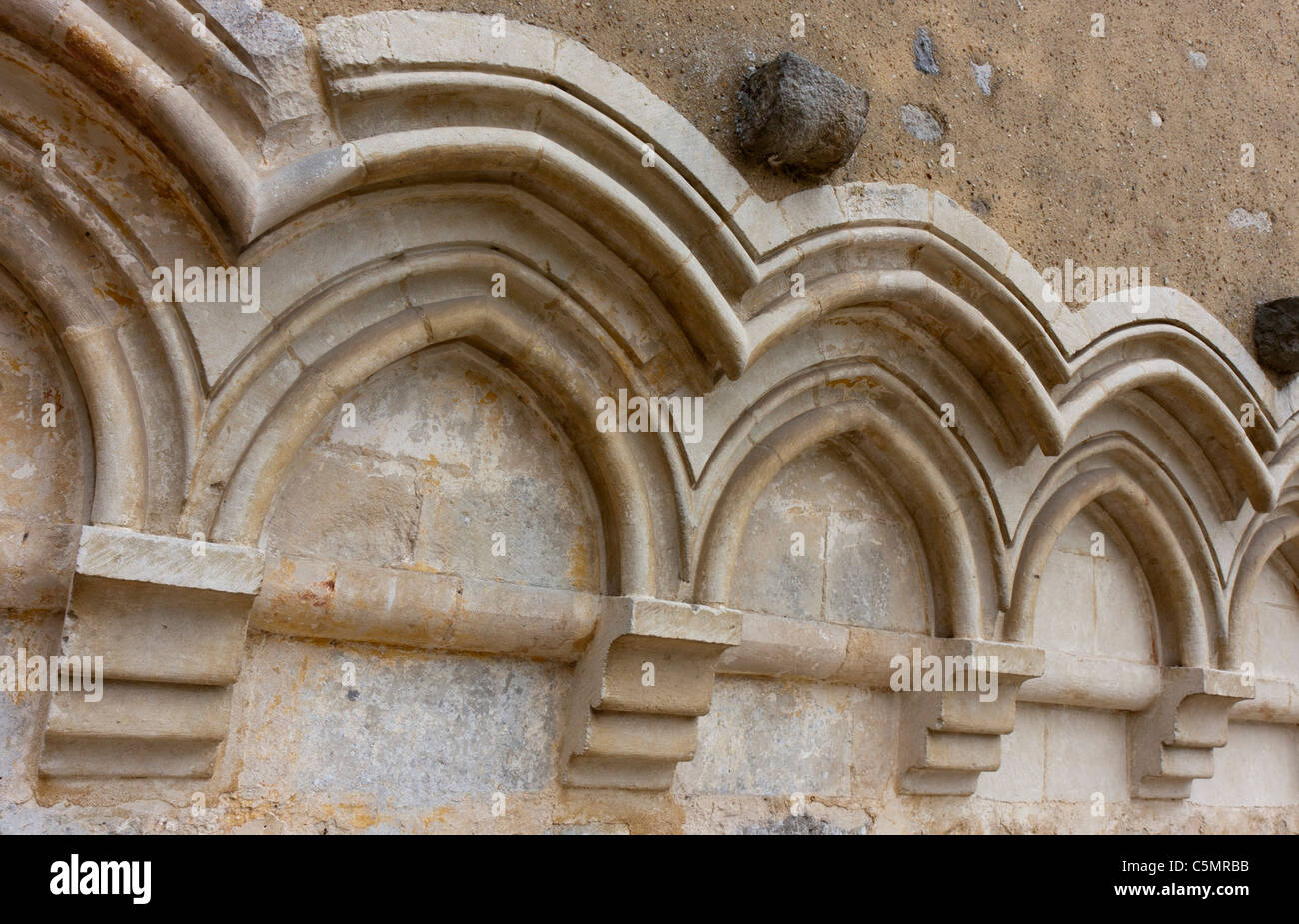 Cascade Of Traditional Gothic Arches With Simple Archivolts On A Religious Building Wall