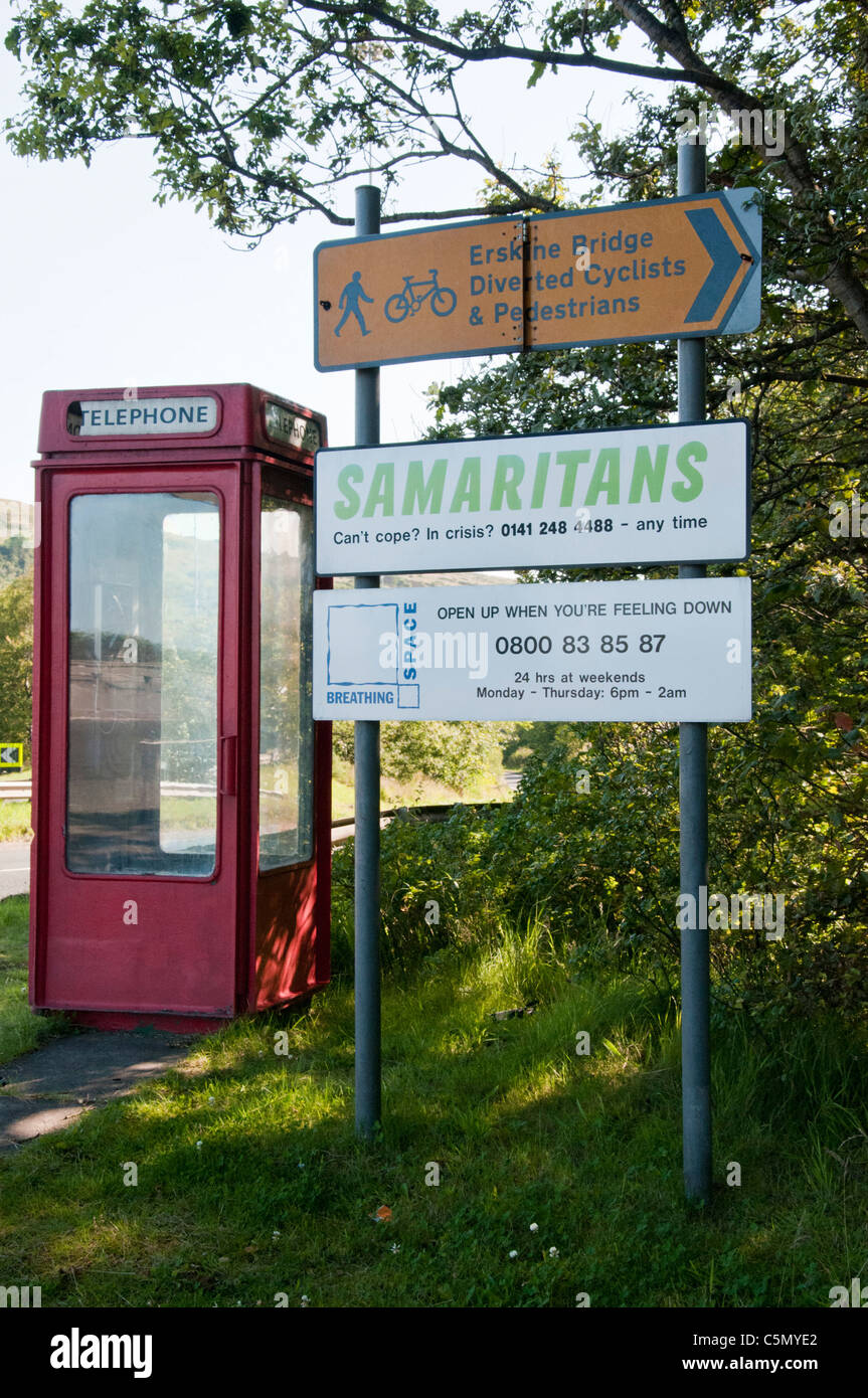 Telephone box near to  Erskine Bridge with Samaritans and counseling information in an attempt to reduce suicides - Stock Image