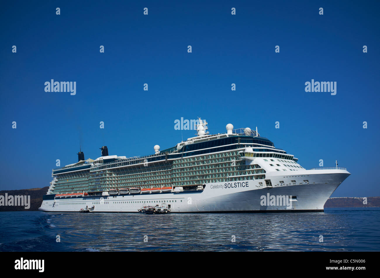 Celebrity Solstice anchored off the Greek island of Santorini built in 2009 built in Meyer Werft in Germany - Stock Image