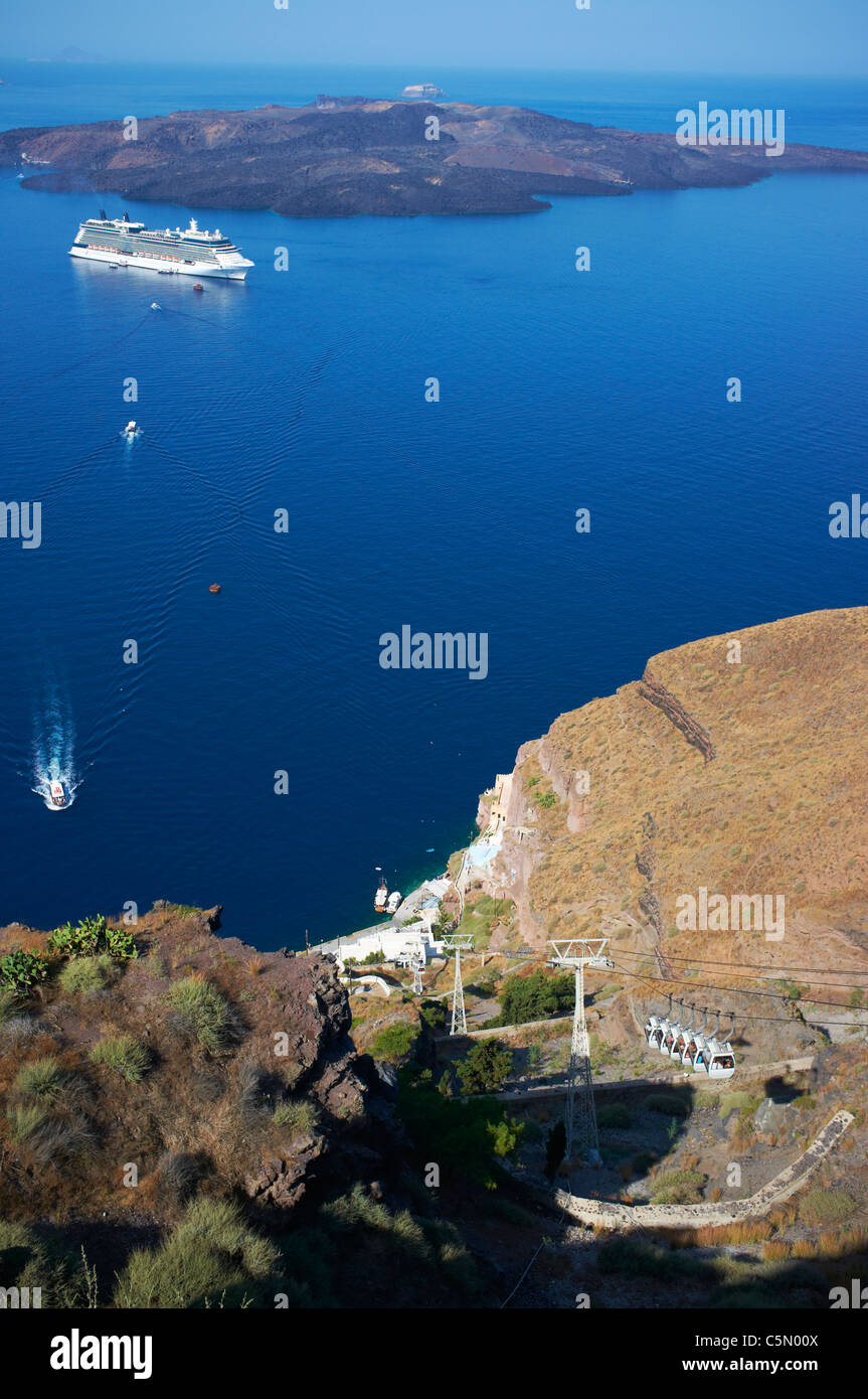 View over the harbour of Santorini or Thera Greece with a cruise ship anchored in the harbour - Stock Image