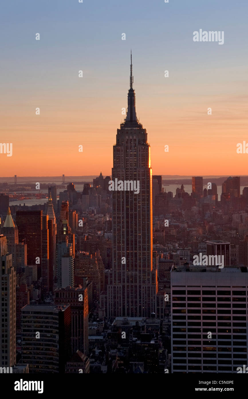 View of city and Empire State Building from the Rockerfeller centre in the early evening light, New York, USA Stock Photo