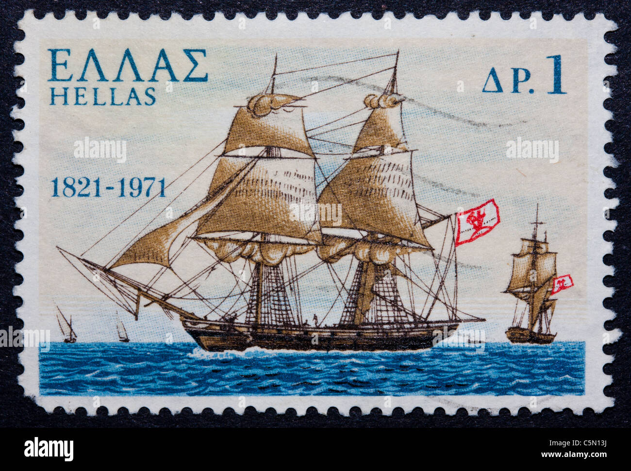 A postmarked Greek stamp showing a ship with sails - Stock Image