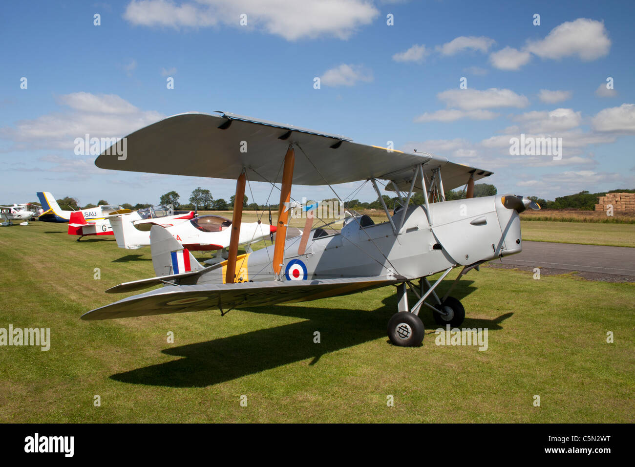 De Havilland DH82A Tiger Moth T7909 G-ANON on the ground at Breighton Airfield - Stock Image