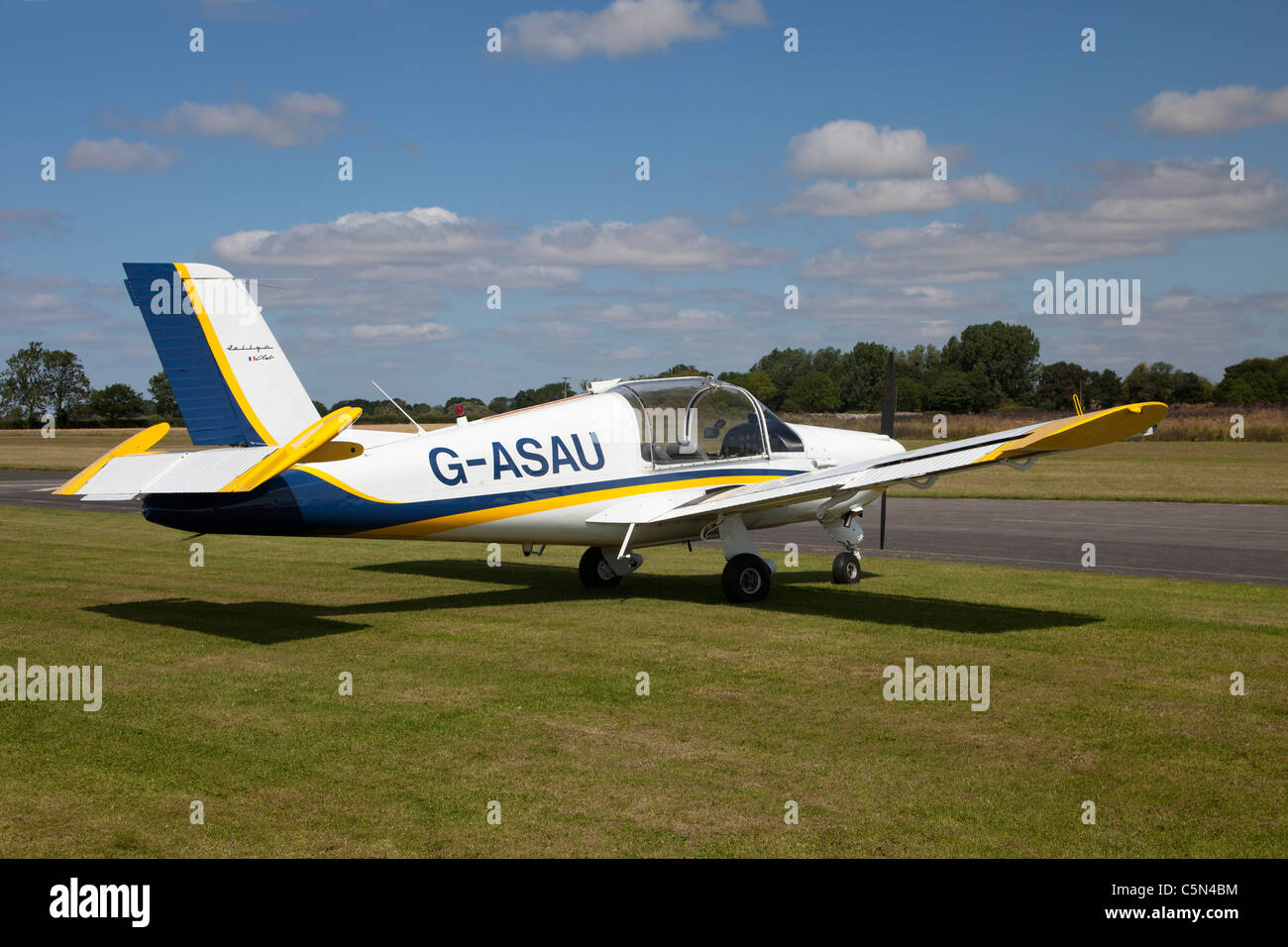 Morane Saulnier MS880B Rallye Club G-ASAU on the ground at Breighton Airfield - Stock Image