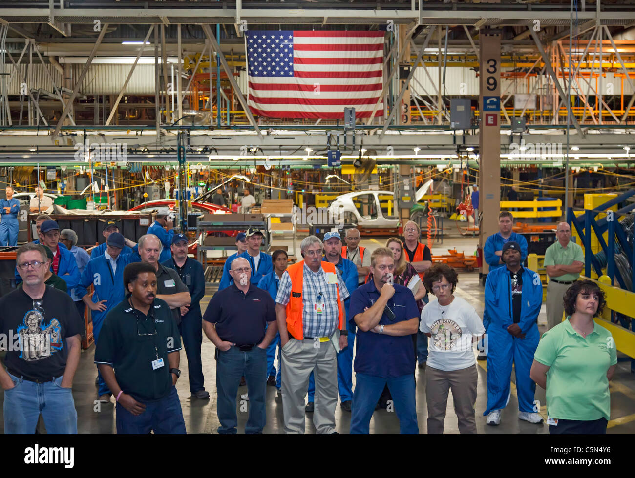 General Motors Workers Listen as Union and Company Officials Begin Contract Negotiations - Stock Image