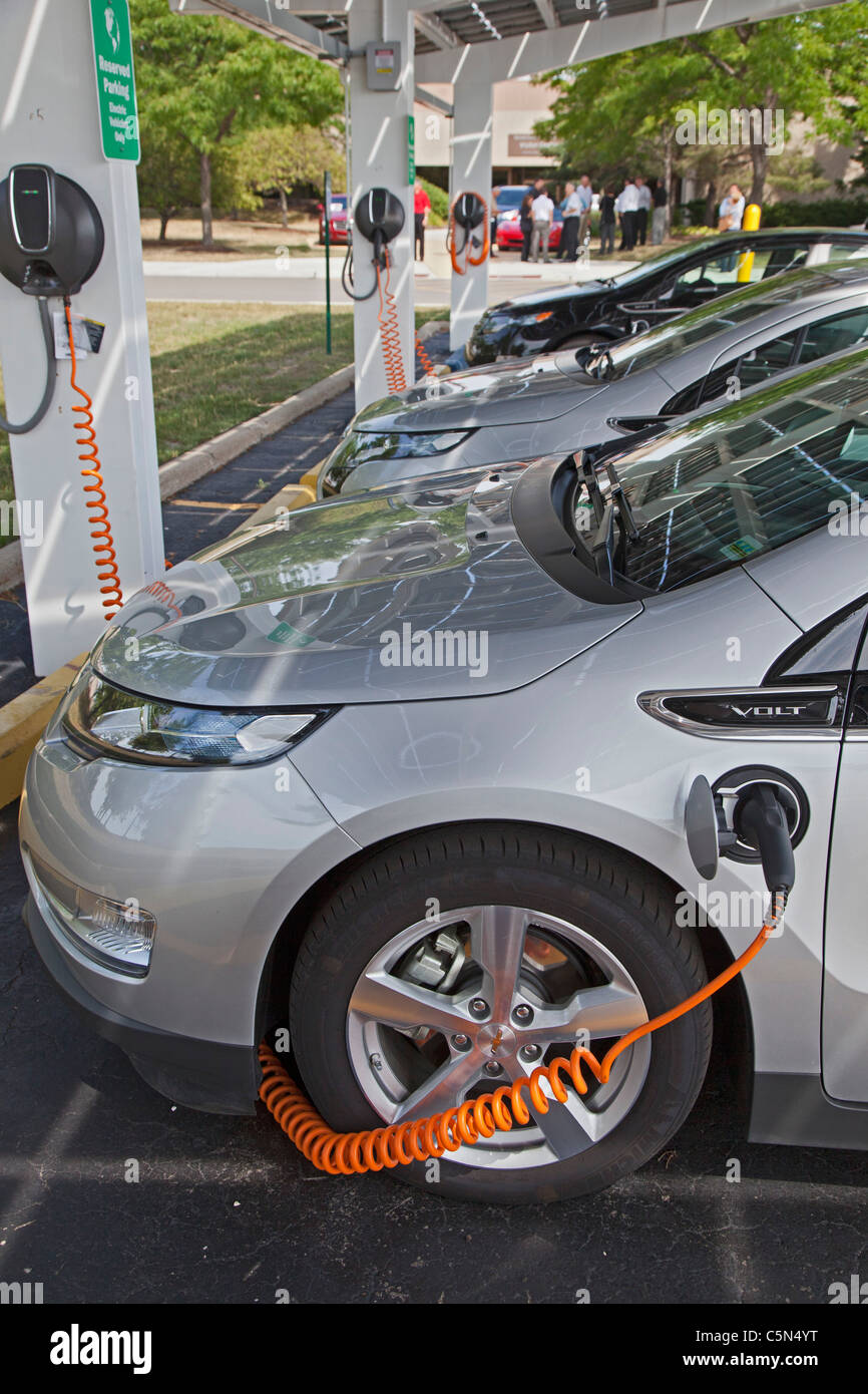 Chevrolet Volt Plug-In Electric Car at Charging Station - Stock Image