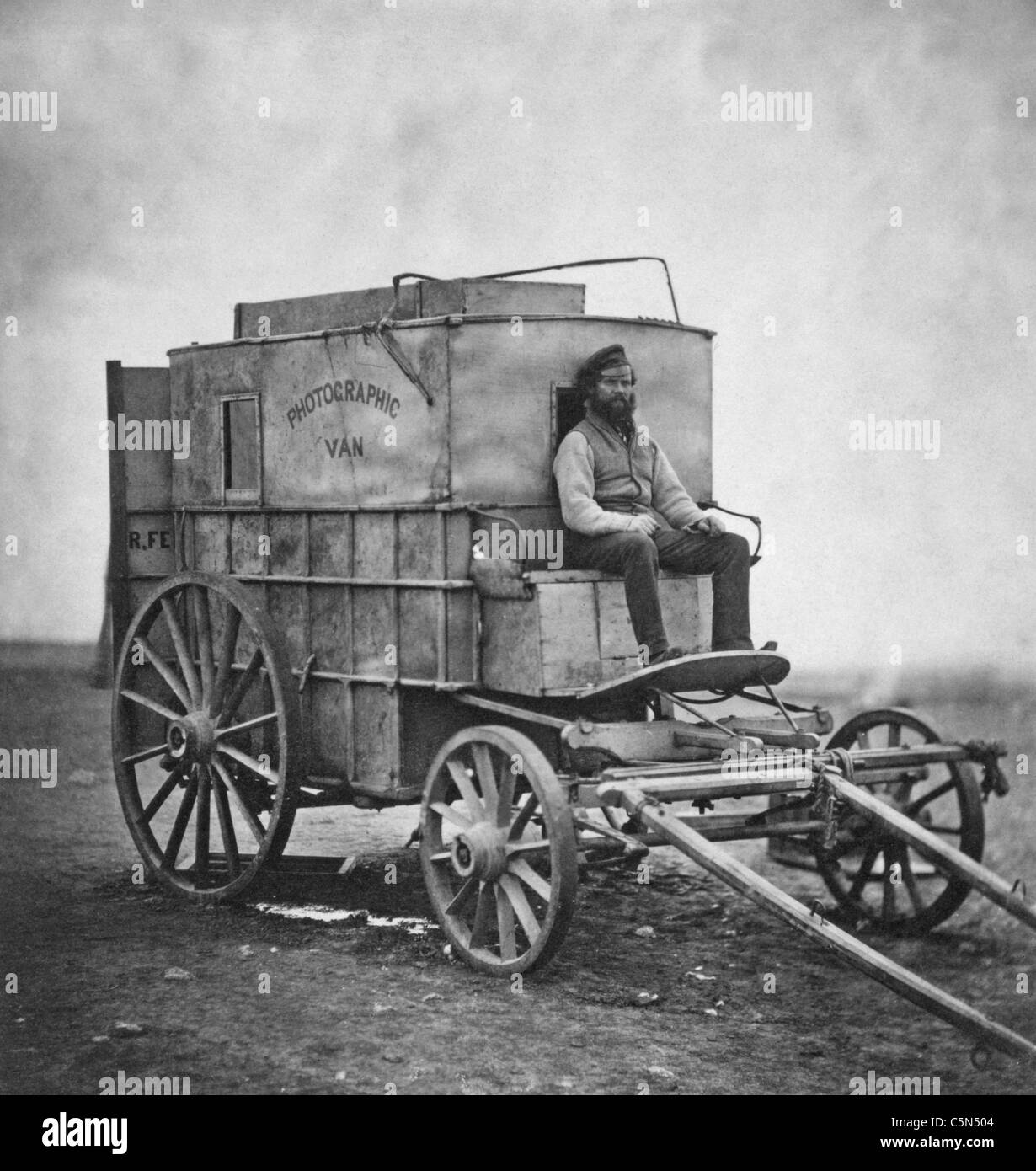Artist's Van -  Marcus Sparling, full-length portrait, seated on Roger Fenton's photographic van, during - Stock Image