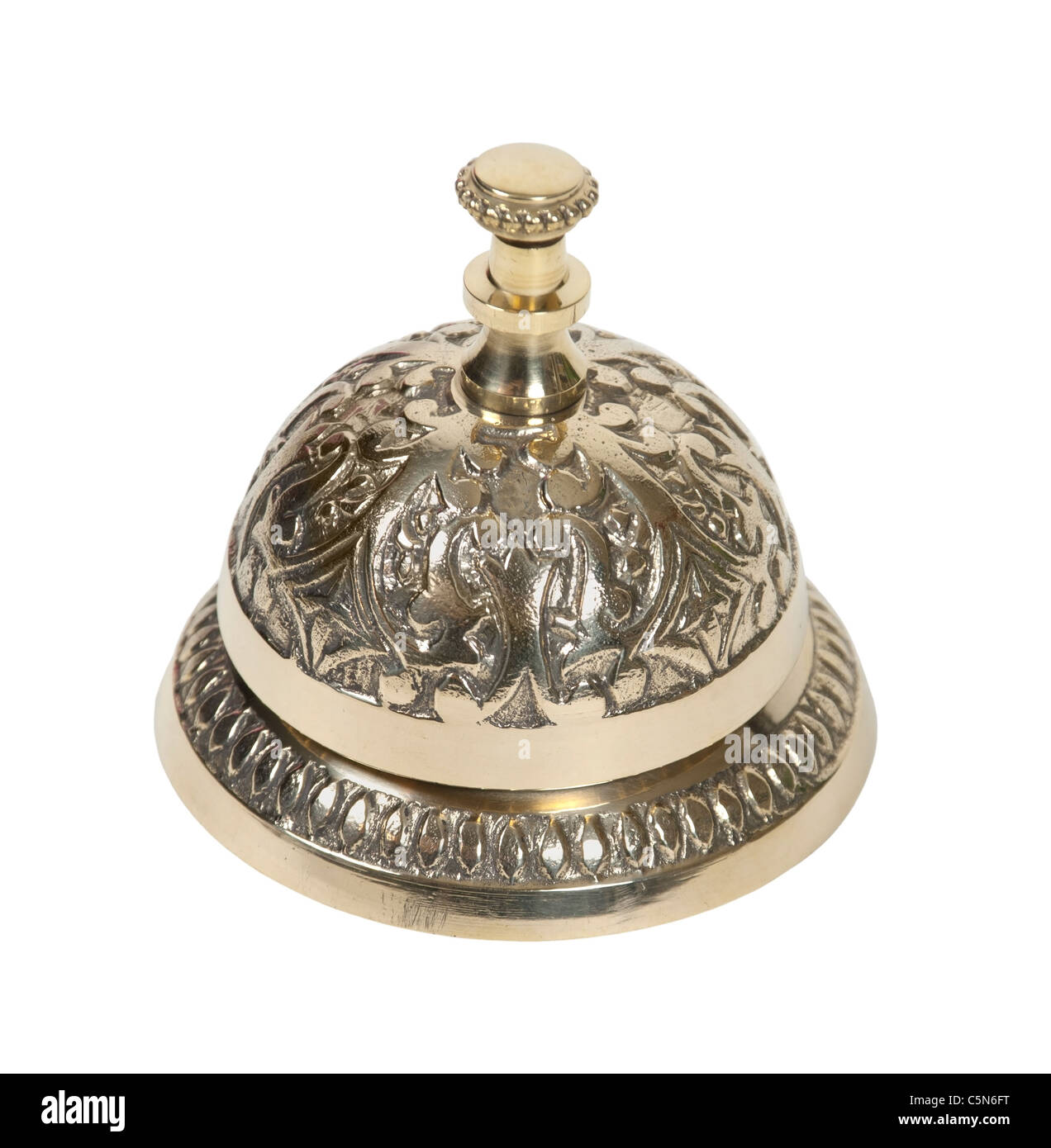 Brass intricate service bell placed on a counter and used to prompt for service - path included - Stock Image