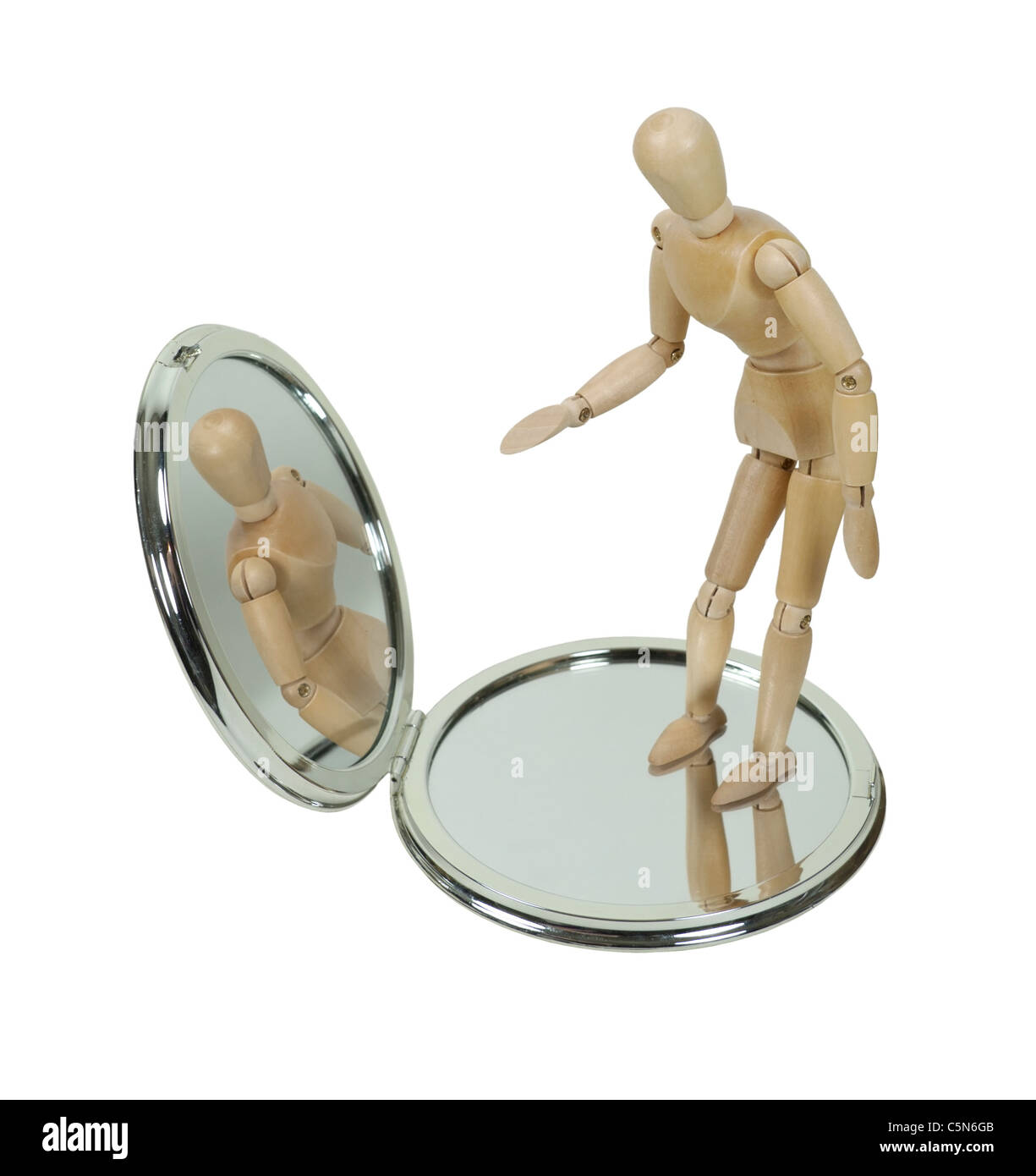 Wooden Model Observing Self in Compact Mirror - path included - Stock Image