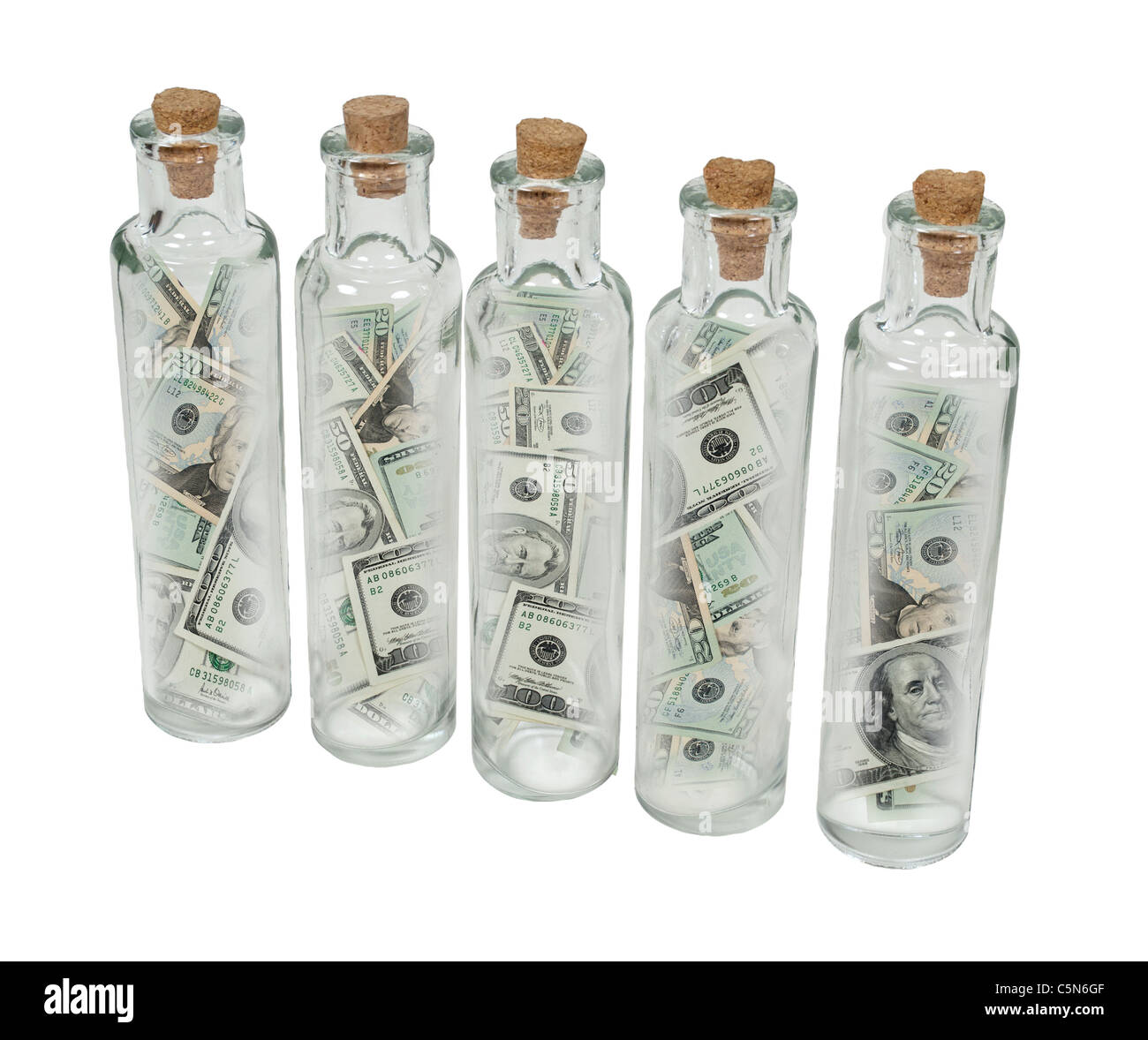 Tall thin glass bottles with cork stoppers full of money - path included - Stock Image