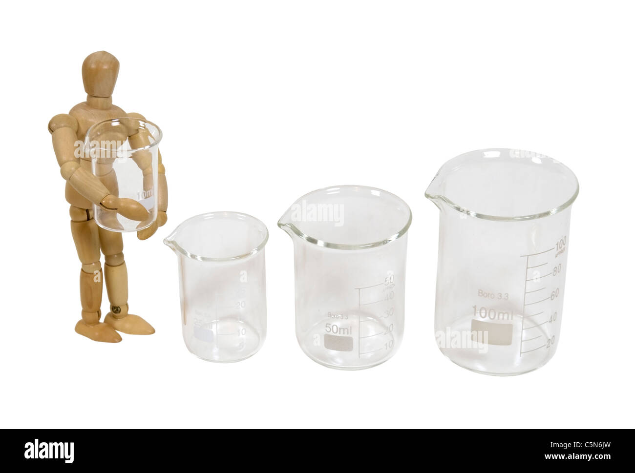 Holding a glass beaker used to measure and store liquids during research projects - path included Stock Photo
