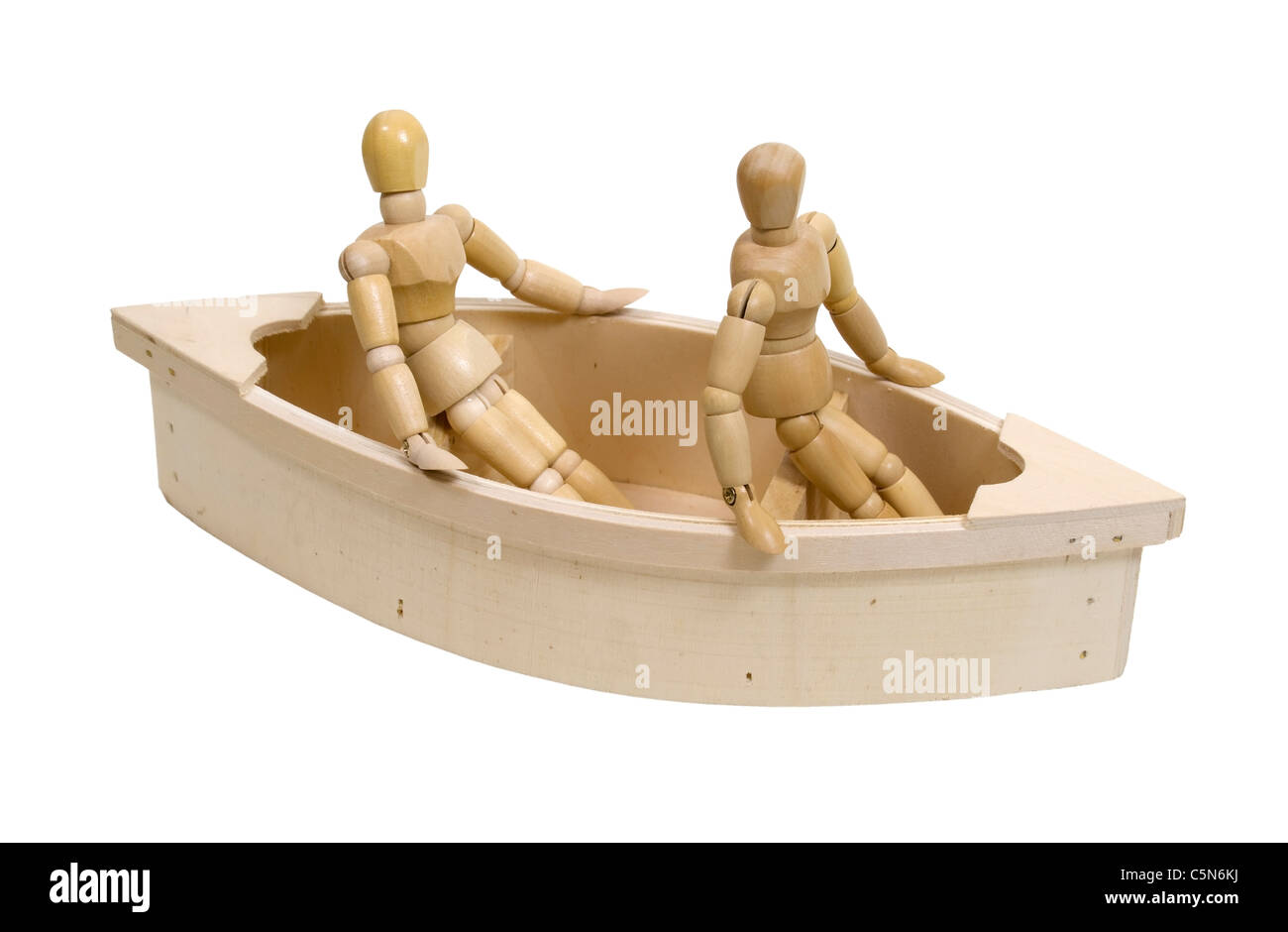 Wooden models representing people relaxing in a boat - path included - Stock Image