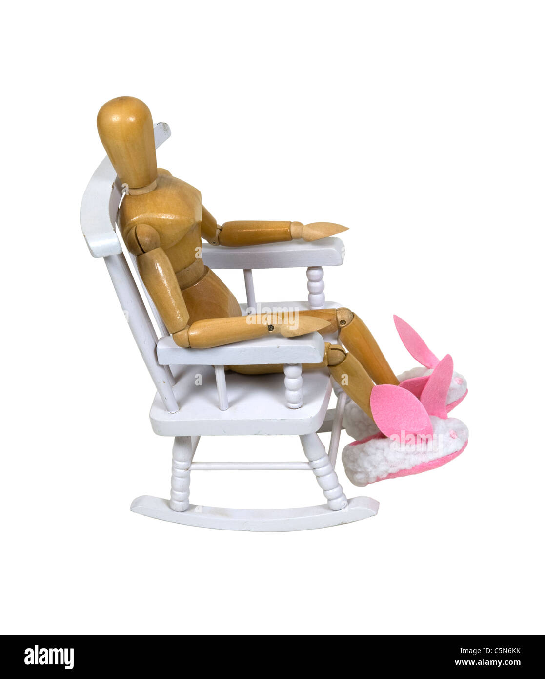 Relaxing in a rocking chair wearing fuzzy bunny slippers with large pink ears and nose - path included - Stock Image