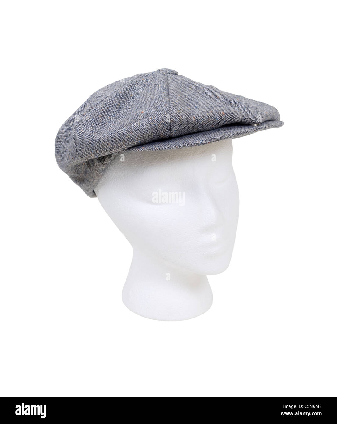 Wearing a masculine tweed flat driving cap worn on the head when out for a drive - path included - Stock Image