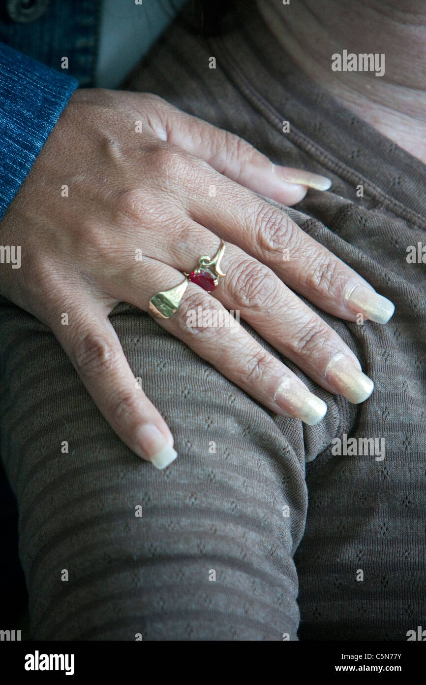 Cuba, Cienfuegos. Long Fingernails Designate a Professional Woman ...