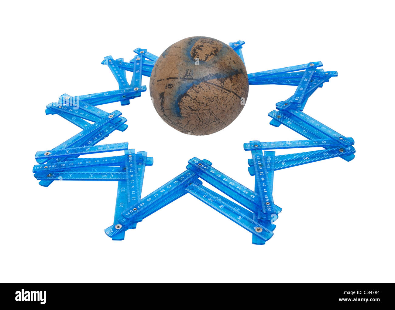 Measuring world stars shown by an old world globe with folding rulers making the shape of a star - path included - Stock Image