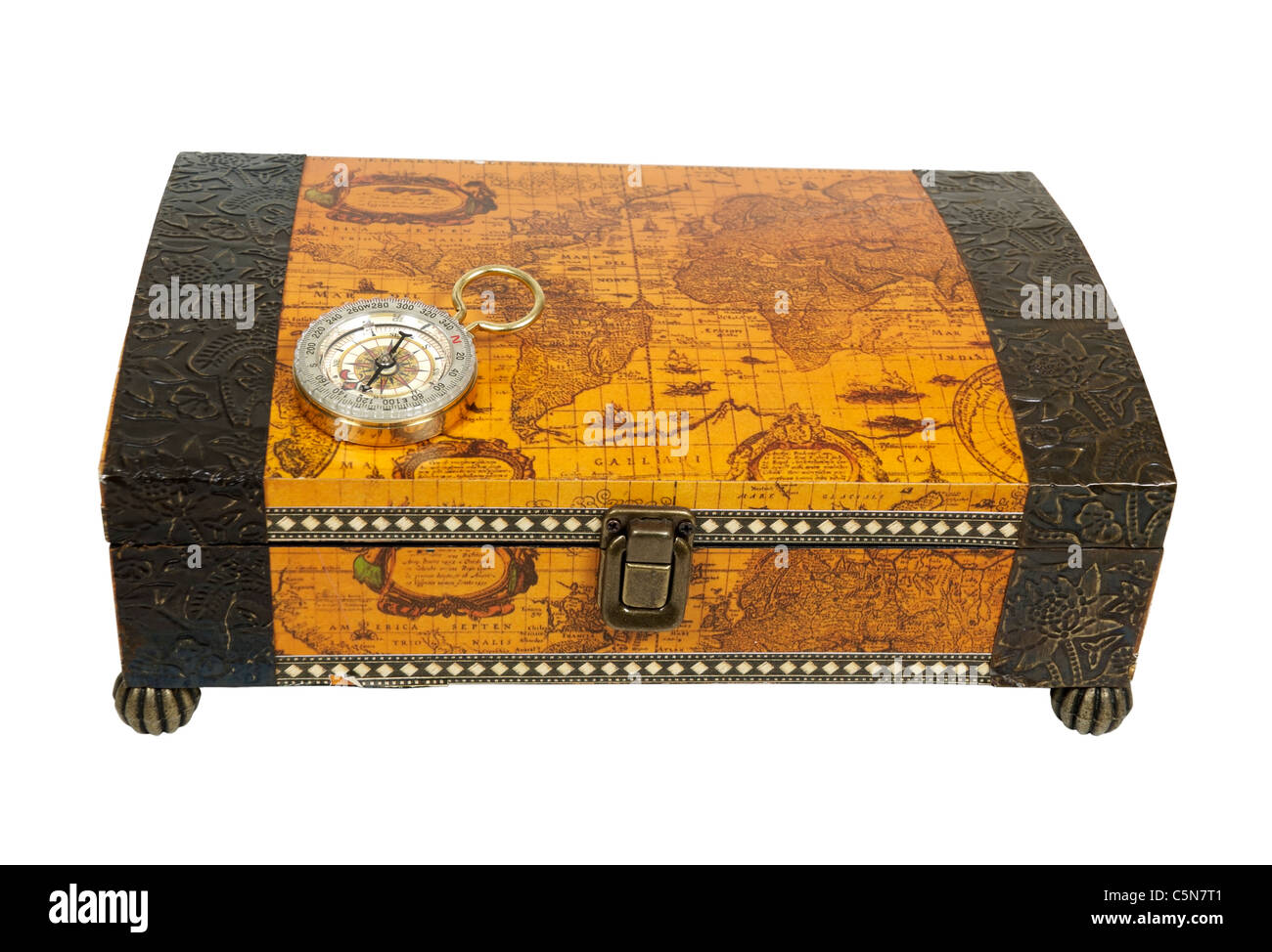 Travel box for storing vacation memories and a compass used for navigational purposes - path included - Stock Image