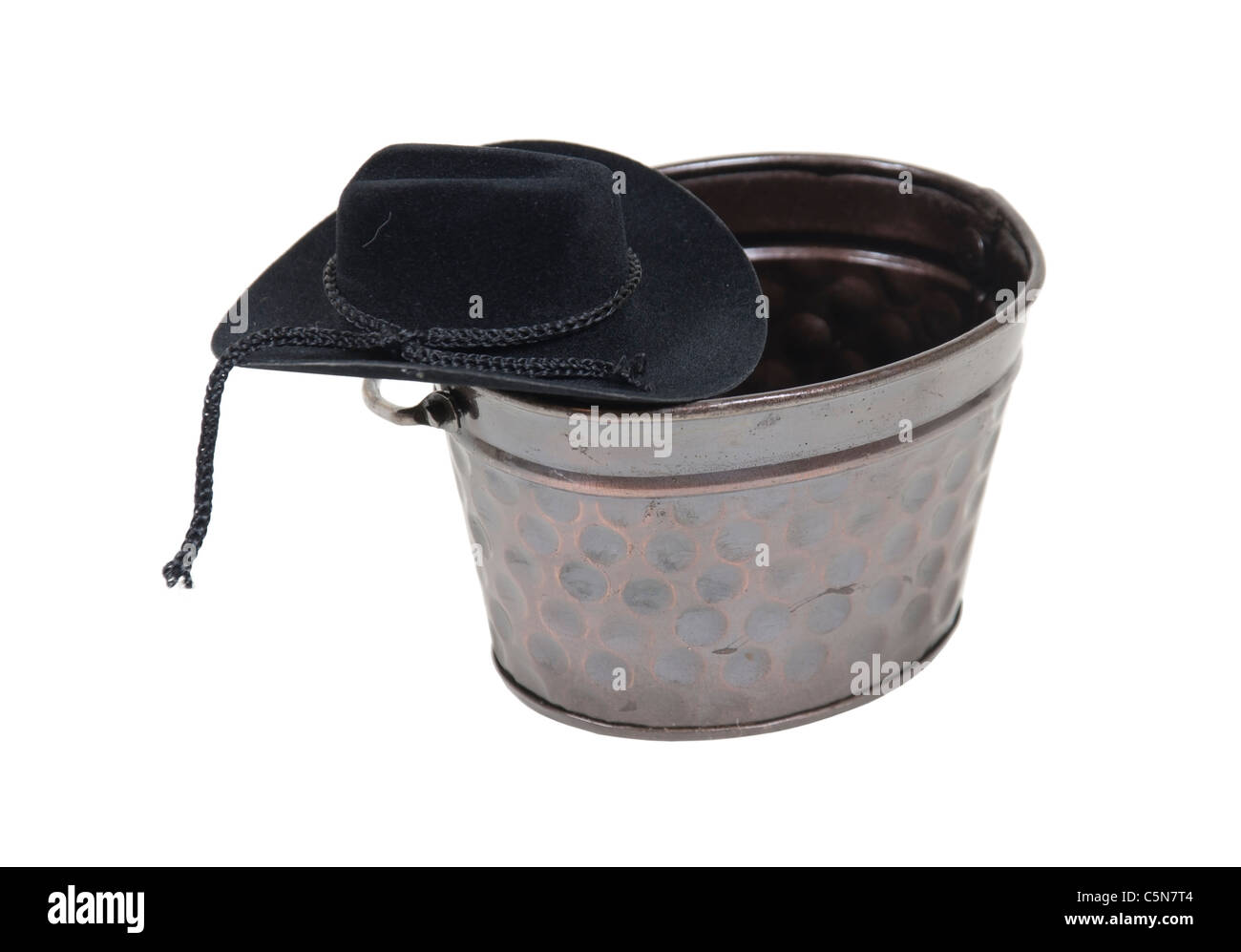 At the watering hole shown by a cowboy hat on a metal watering trough - path included - Stock Image