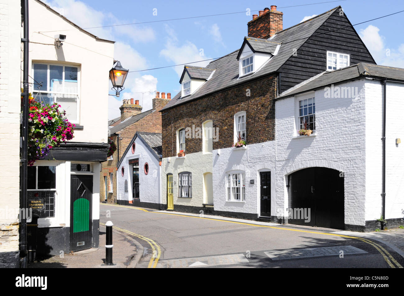 Cottages with front door opening onto narrow road with no pavement in High Street Old Leigh on Sea Essex England - Stock Image