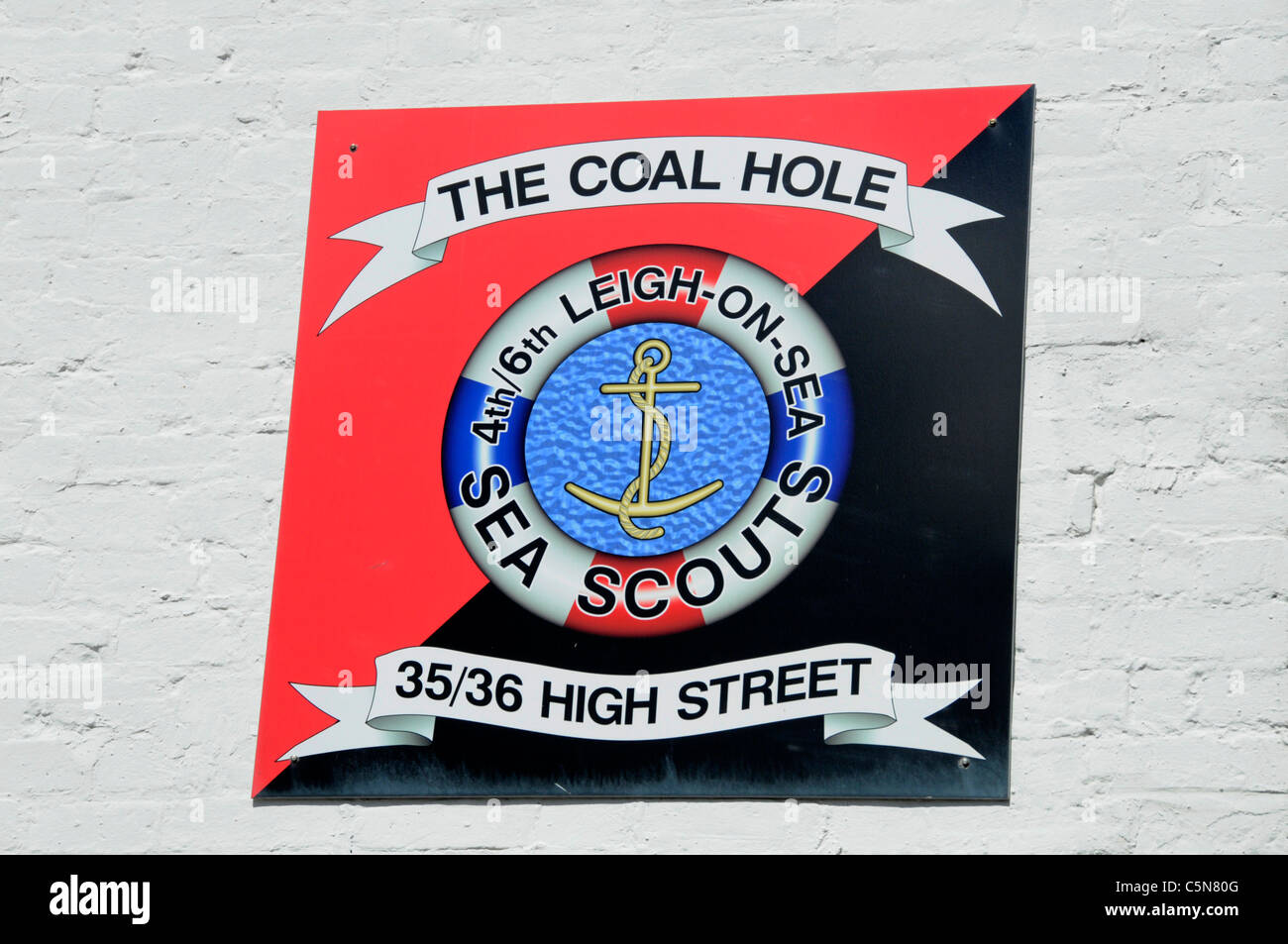 Sea Scouts sign on wall High Street Leigh on Sea Essex England UK - Stock Image