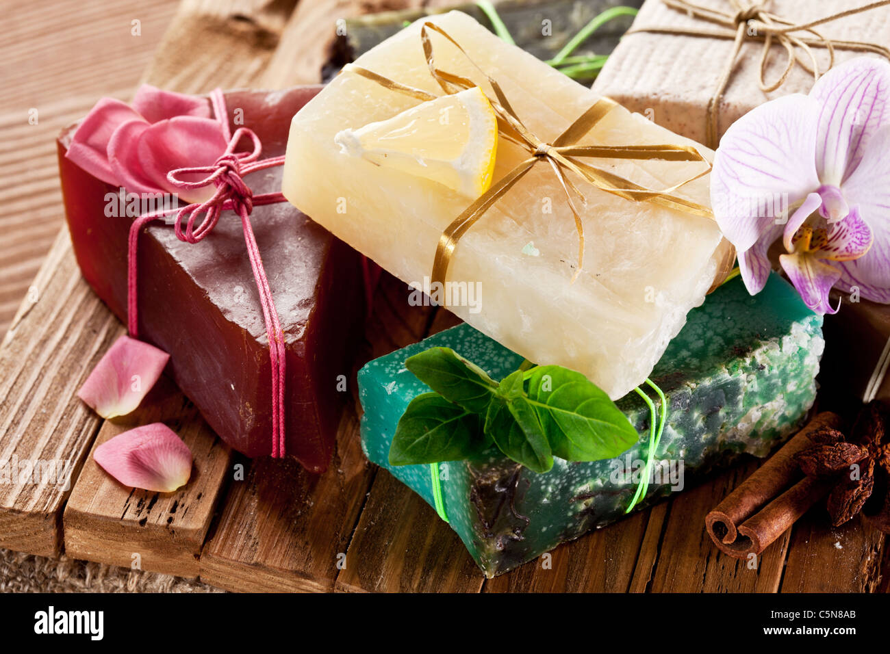 Pieces of natural soap on the wood desk. - Stock Image