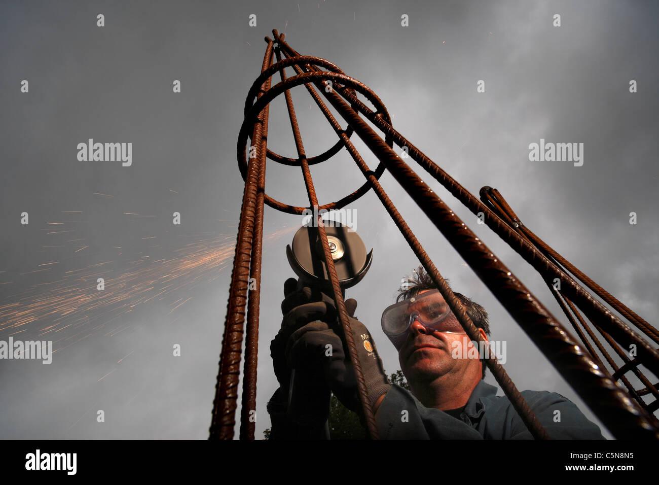 A steel fabricator making a plant obelisk Stock Photo