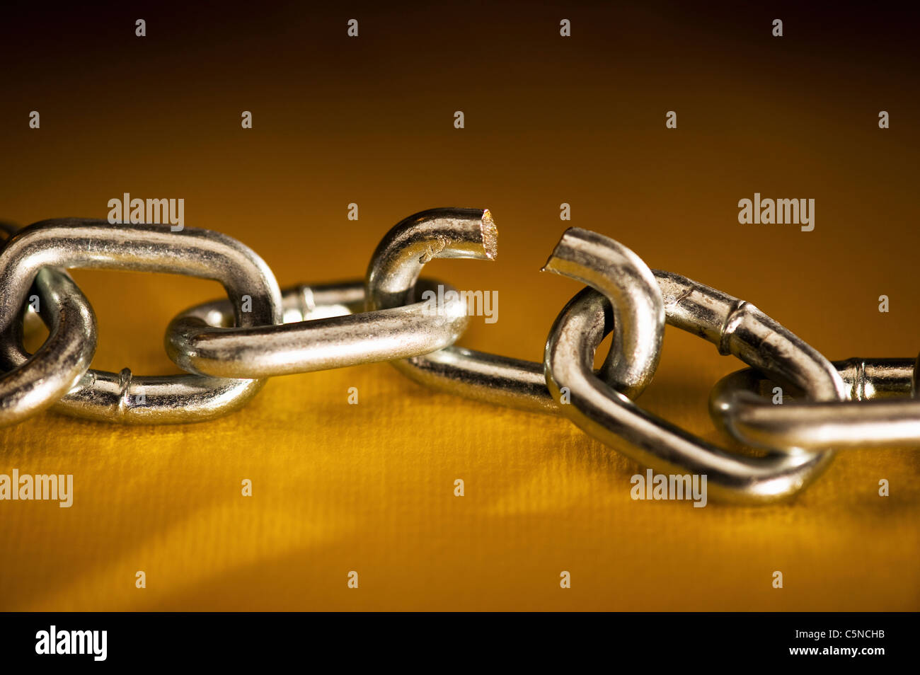 A chain with a broken link - Stock Image