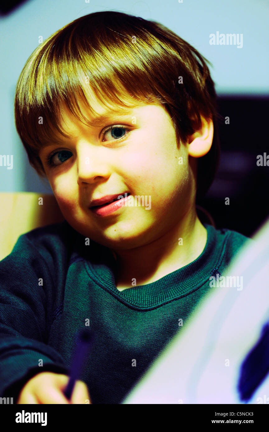 Portrait of a young boy smiling - Stock Image