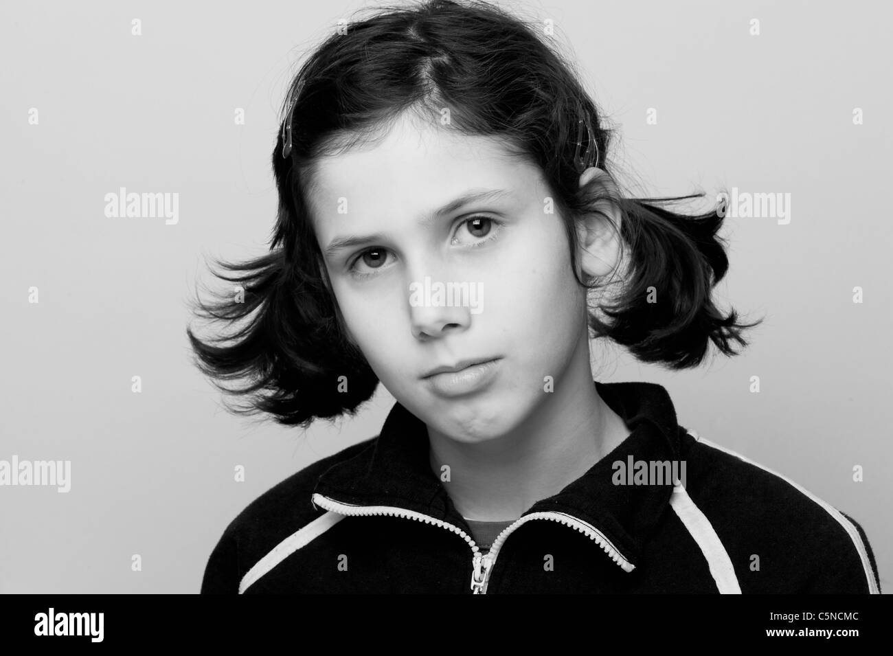Portrait of a young girl, looking unhappy Stock Photo