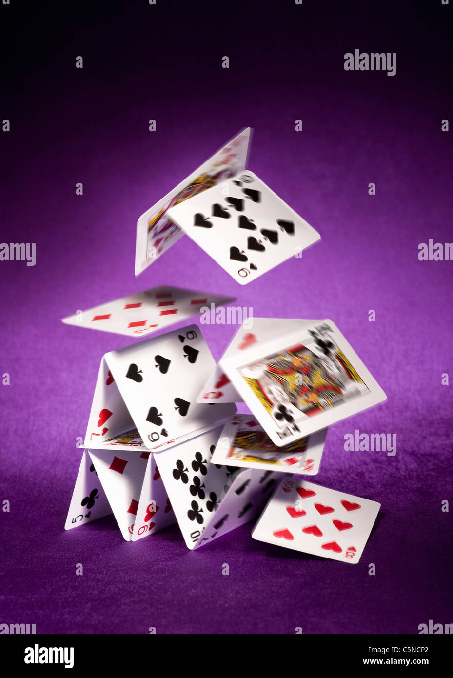 A house of cards falling down - Stock Image