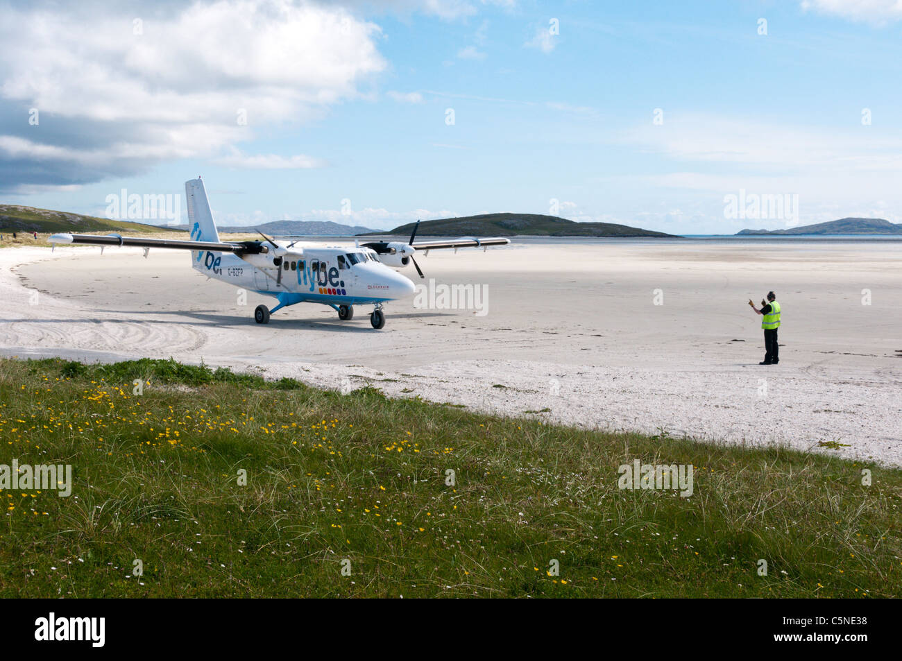 A de Havilland DHC-6 Twin Otter plane of Flybe - Loganair on the beach airstrip on the island of Barra in the Outer Stock Photo